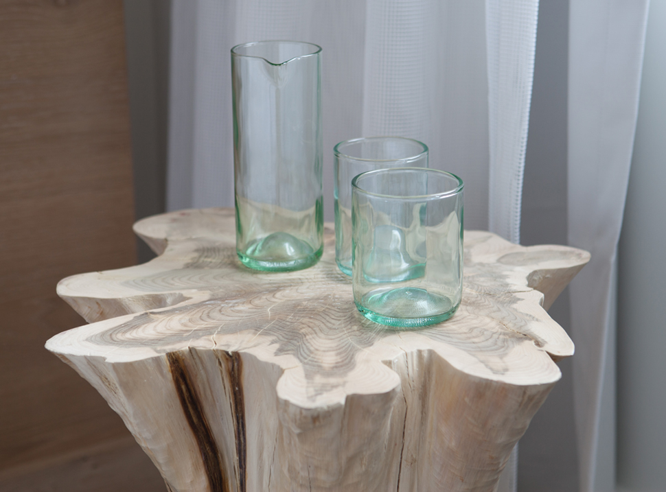3 glasses sitting on a wood table