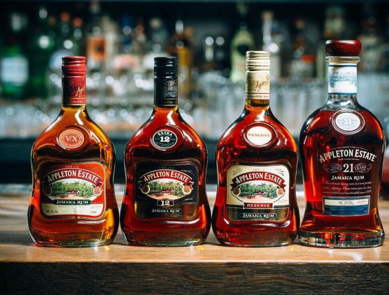 Four Appleton Rum Bottles