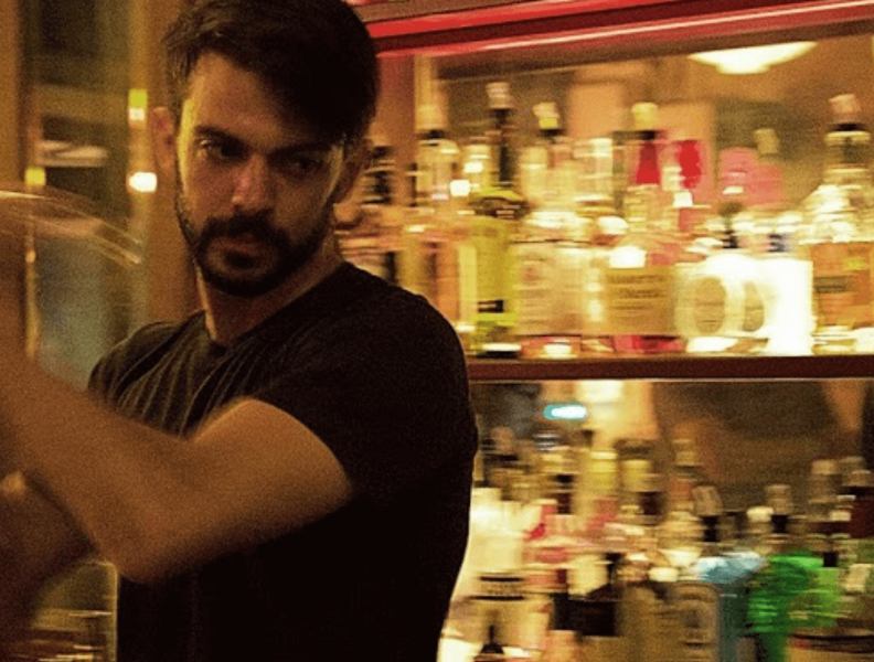 Barrender making drinks at a bar