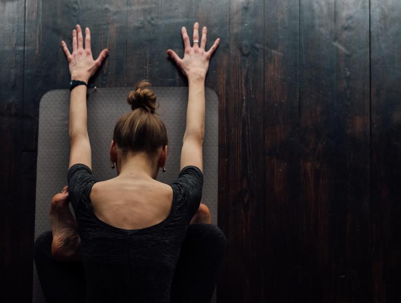woman doing yoga stretch