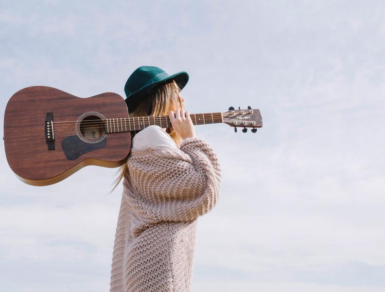 Woman Carrying Guitar