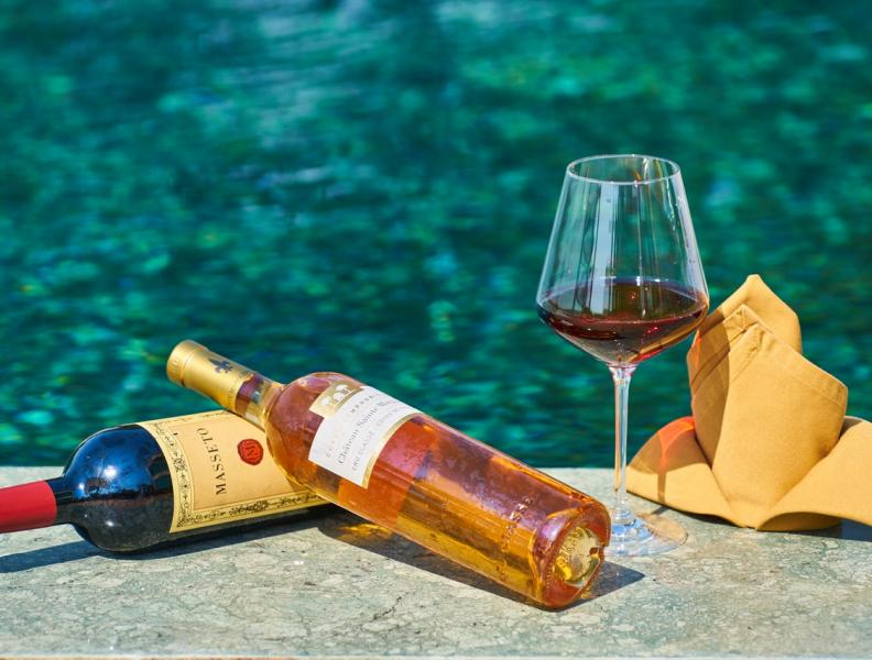 wine bottles by the pool