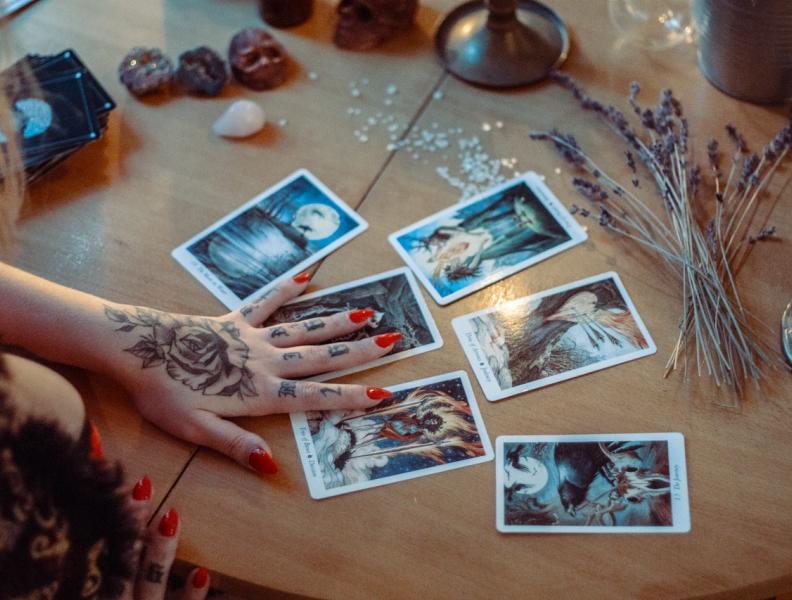 Hand and tarot cards