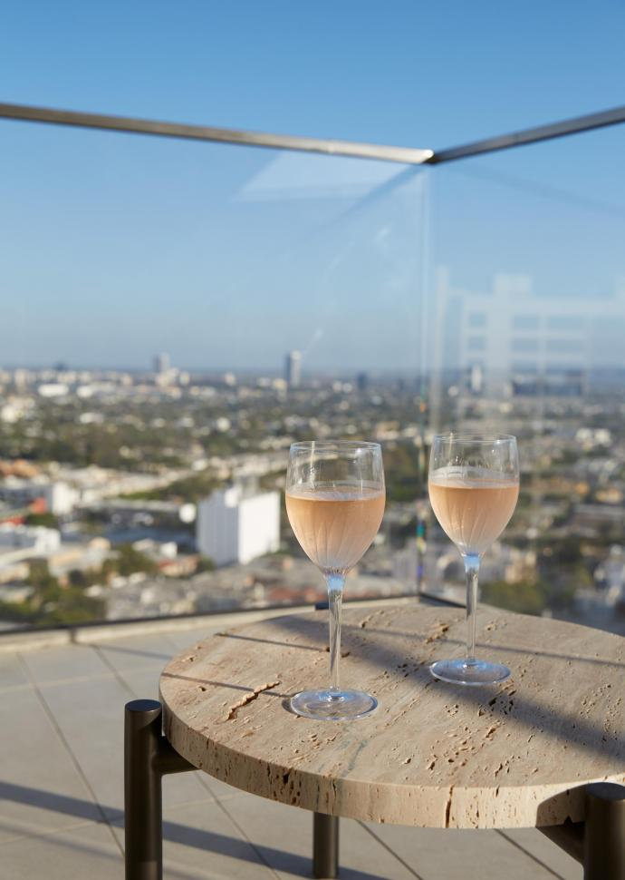 two wine glasses on a balcony side table