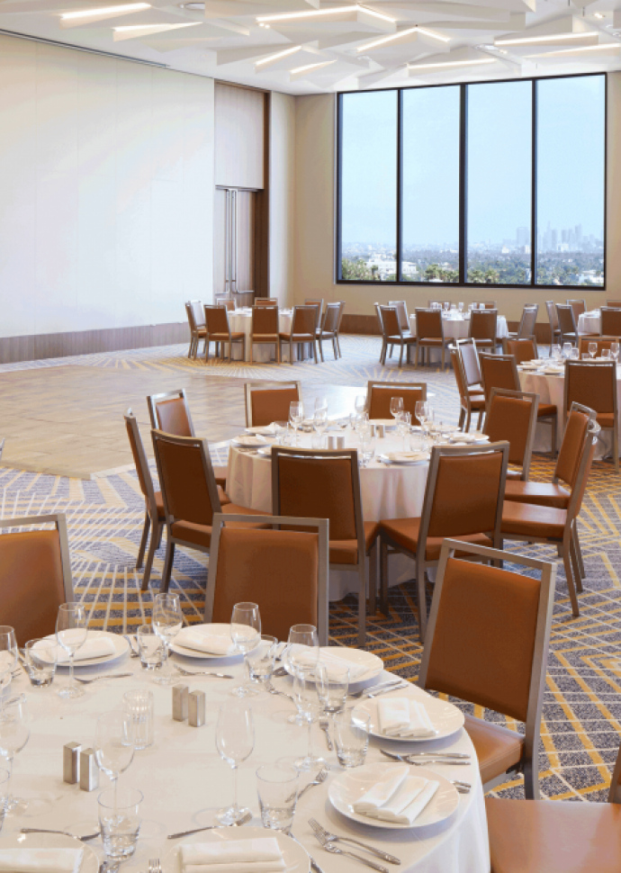 Tables and chairs in the banquet hall at 1 Hotel West Hollywood