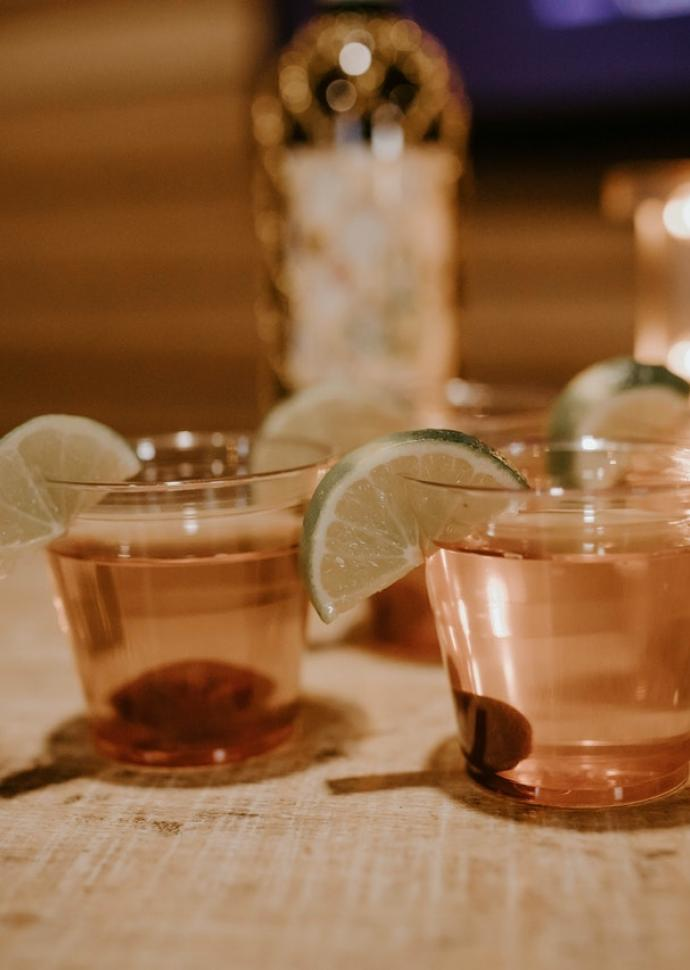 Tequila in shot glasses with lime wedge