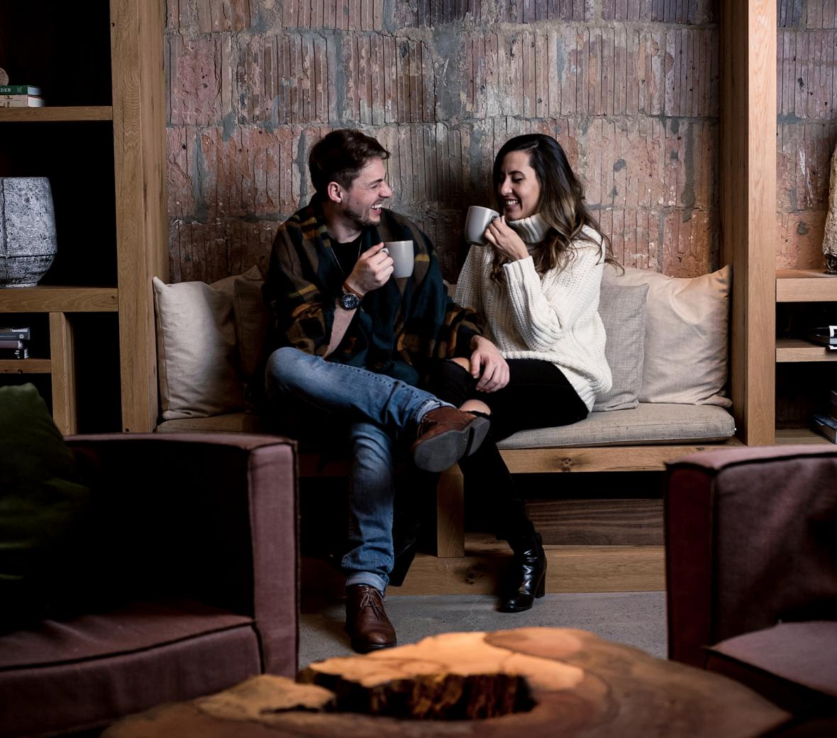 Couple on couch drinking coffee