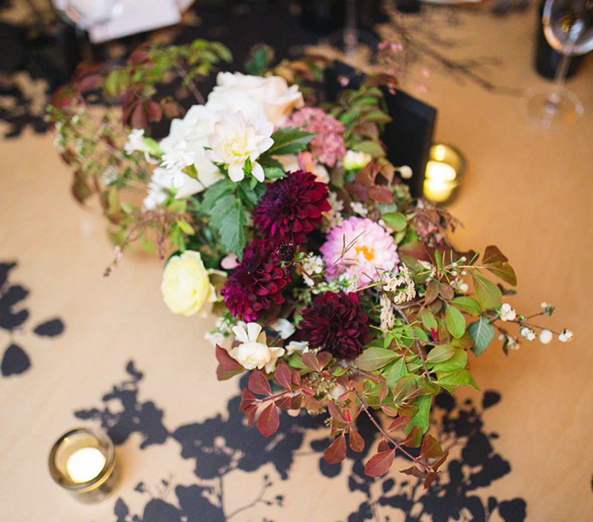 A colorful flower arrangement on a wooden table.
