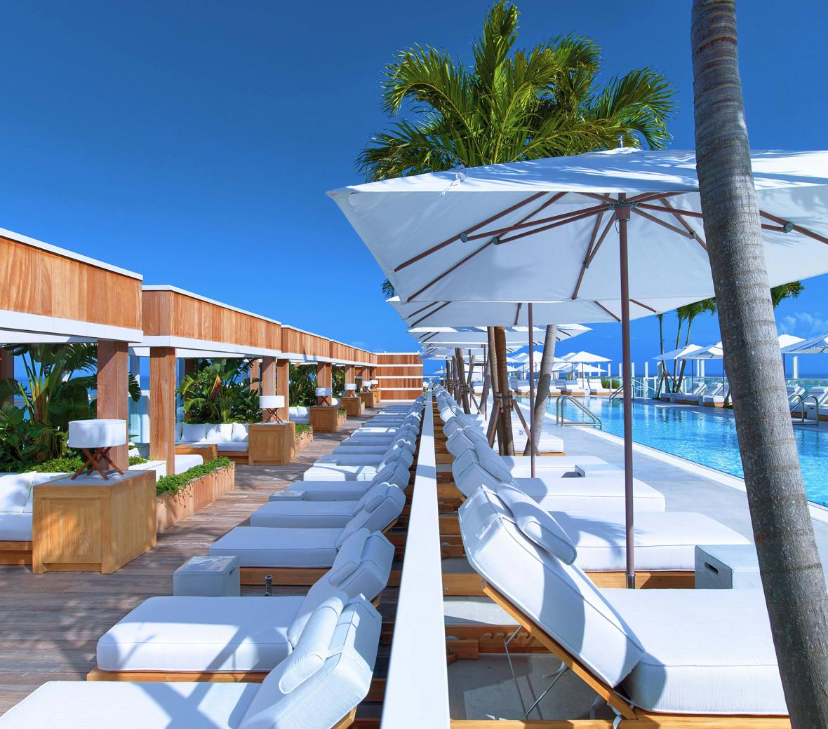 Pool-side cabanas at 1 Hotel South Beach in Miami, Florida.