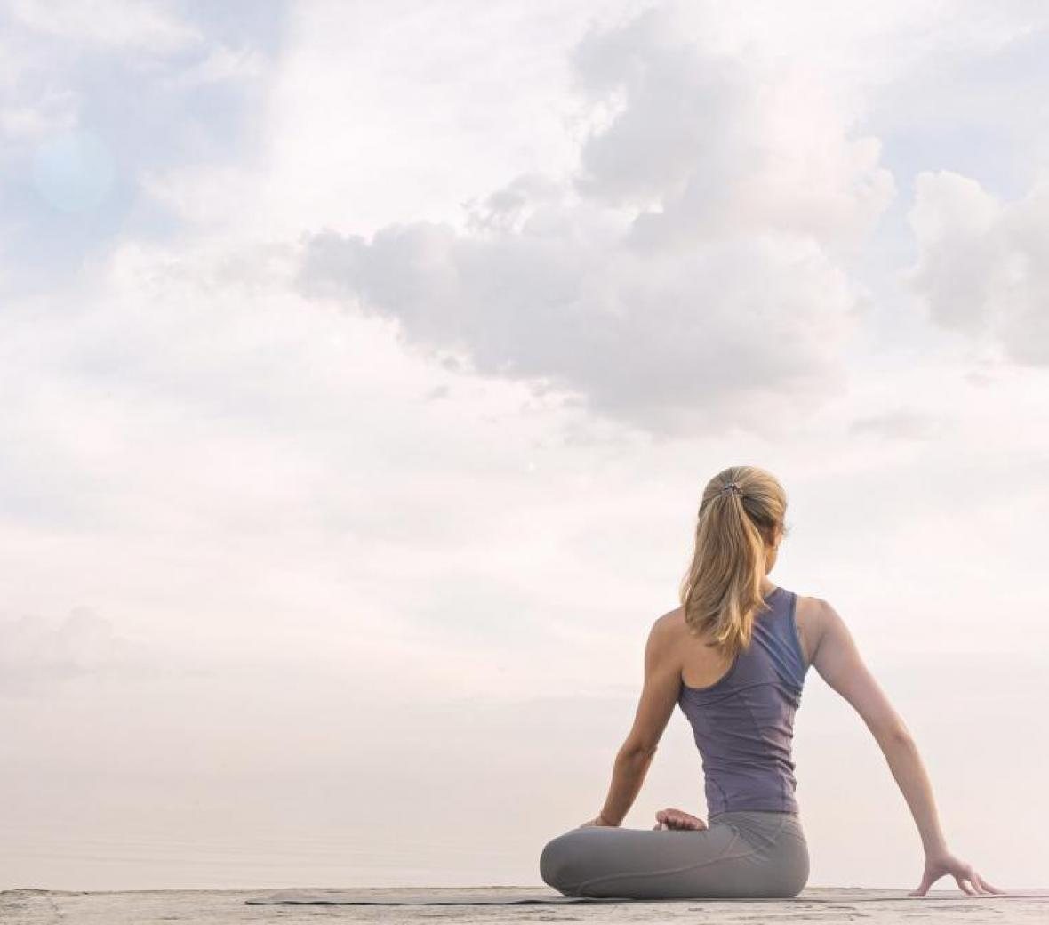 A woman doing yoga on a beach