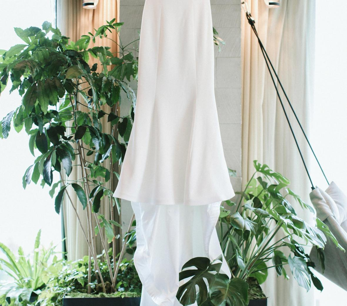 Wedding dress hanging from the ceiling