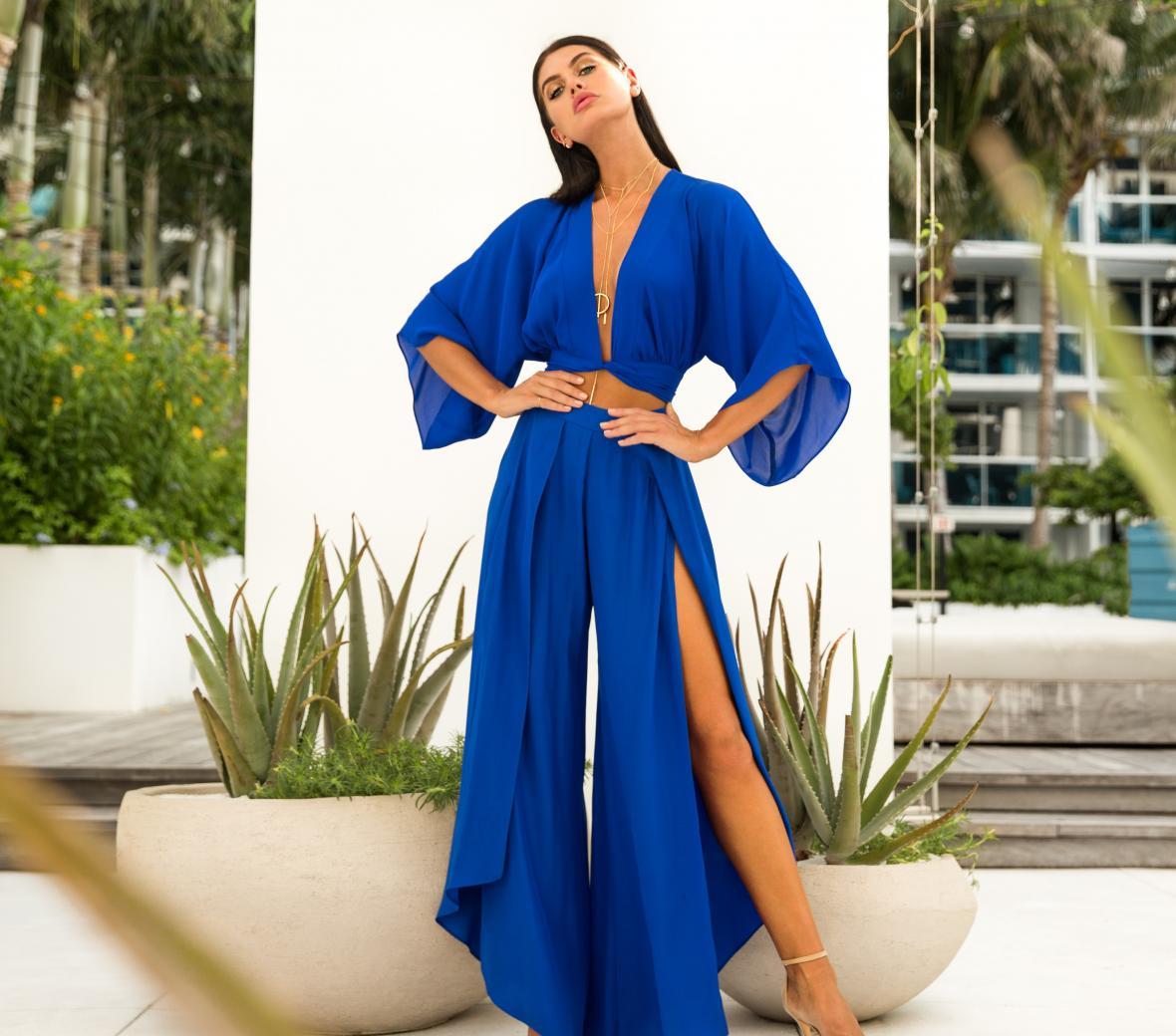 Woman posing in Big Drop NYC blue dress