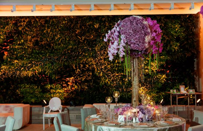 elaborate floral centerpiece in wedding ballroom