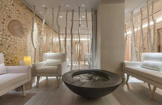 spa interior with birch tree accents and white leather couches