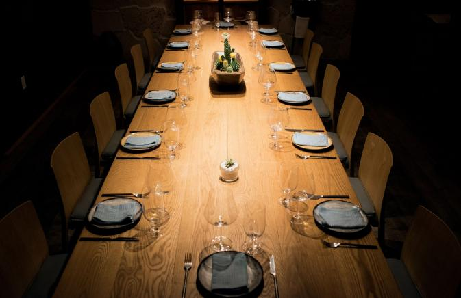 Formal table setting at long wooden table