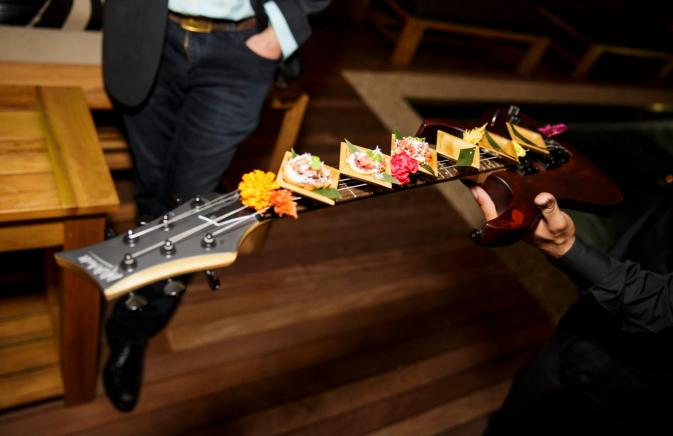 food presented on guitar neck