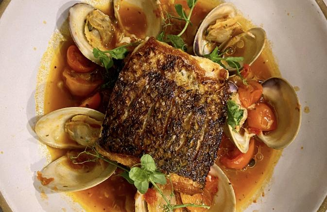 Striped Bass with Spicy Tomato Broth, Toasted Fregola & Local Clams
