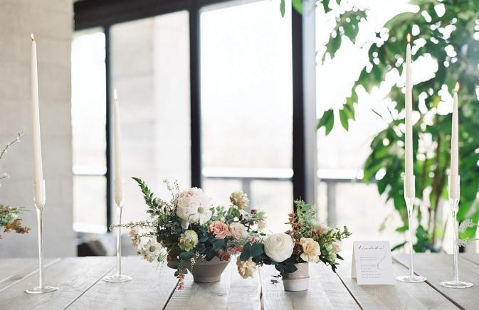 white and pink flower arrangements on a wooden table