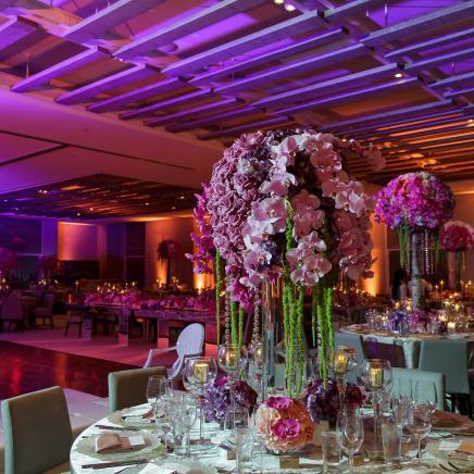 Floral arrangement on banquet table at a wedding