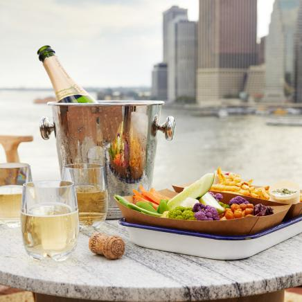 Champagne and snacks on the Rooftop Bar with view of Manhattan skyline