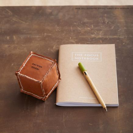 Leather die cube with paper notebook and pen