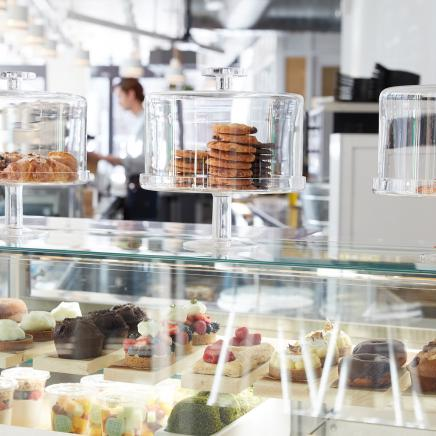 Baked goods on display in glass containers