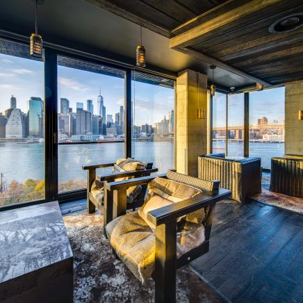 Brooklyn Heights Social Club lounge area with view of Manhattan skyline