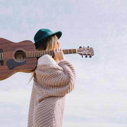 Woman Carrying Guitar