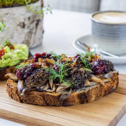 Avocado and mushroom toast with a latte