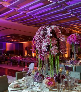 Floral arrangement on banquet table at a wedding