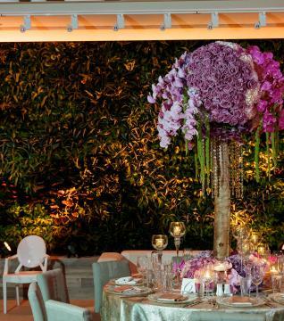 elaborate floral centerpiece in wedding ballroom