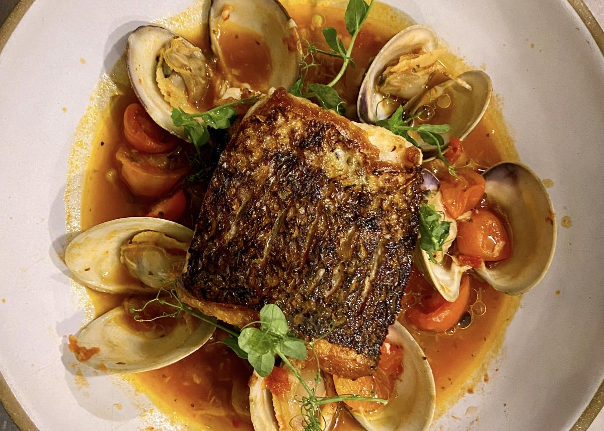 Striped Bass with Spicy Tomato Broth, Toasted Fregola &Local Clams