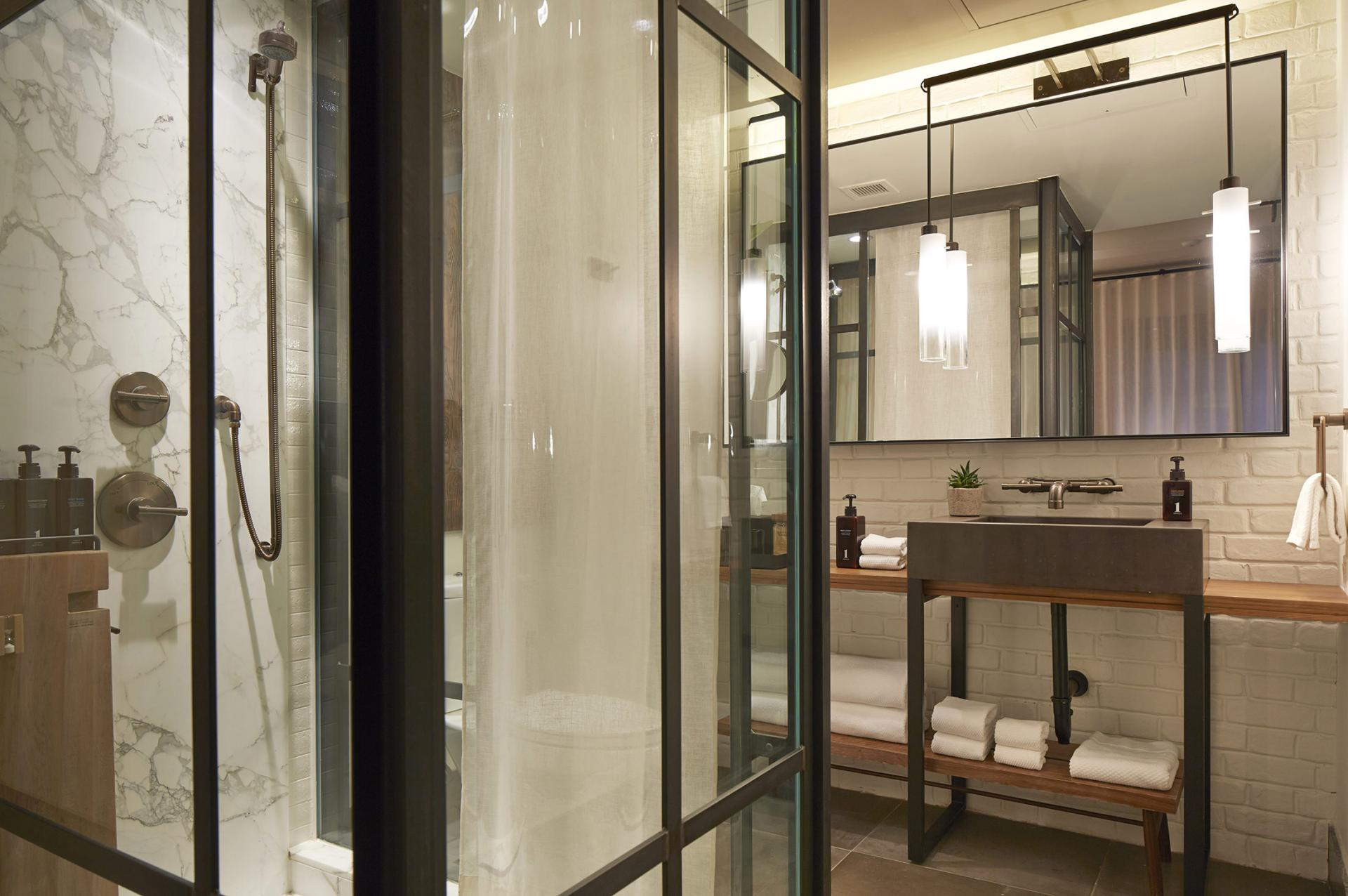 central park suite bathroom with stand up shower and vanity