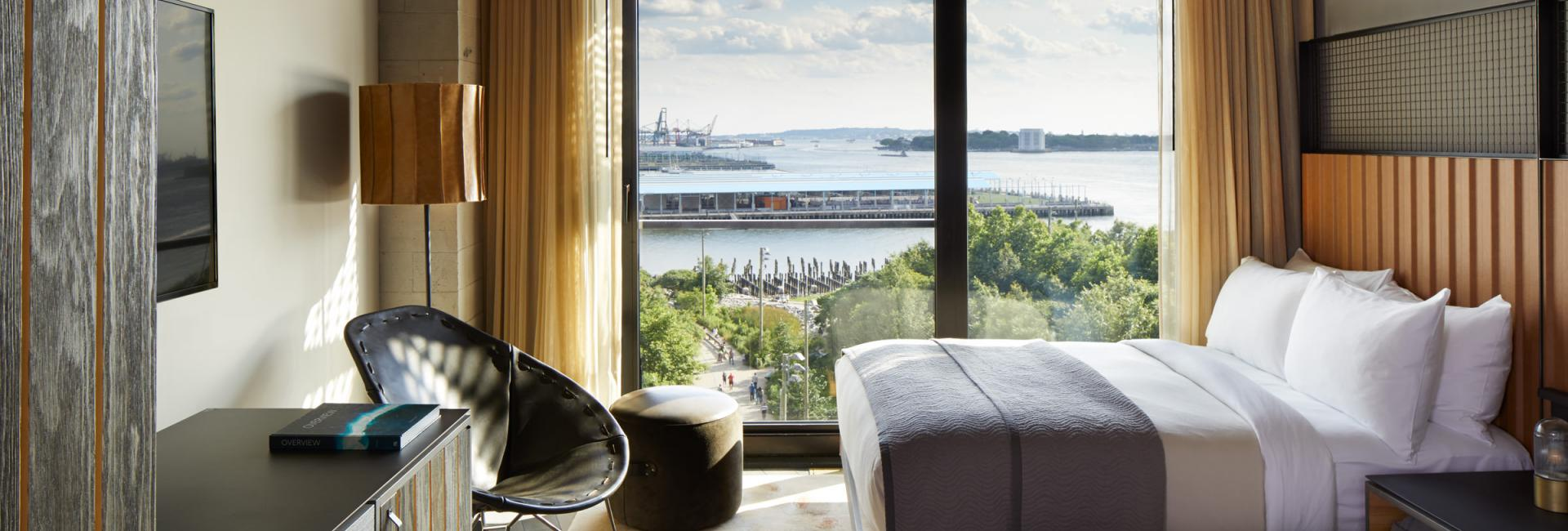 Suite at 1 Hotel Brooklyn Bridge with a view overlooking Pier 1 and the East River.