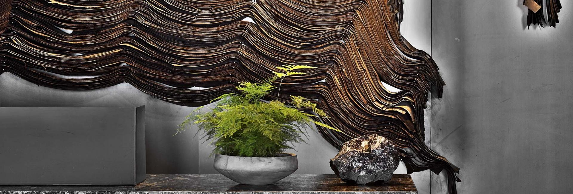 Abstract wall decor behind a marble front lobby desk.