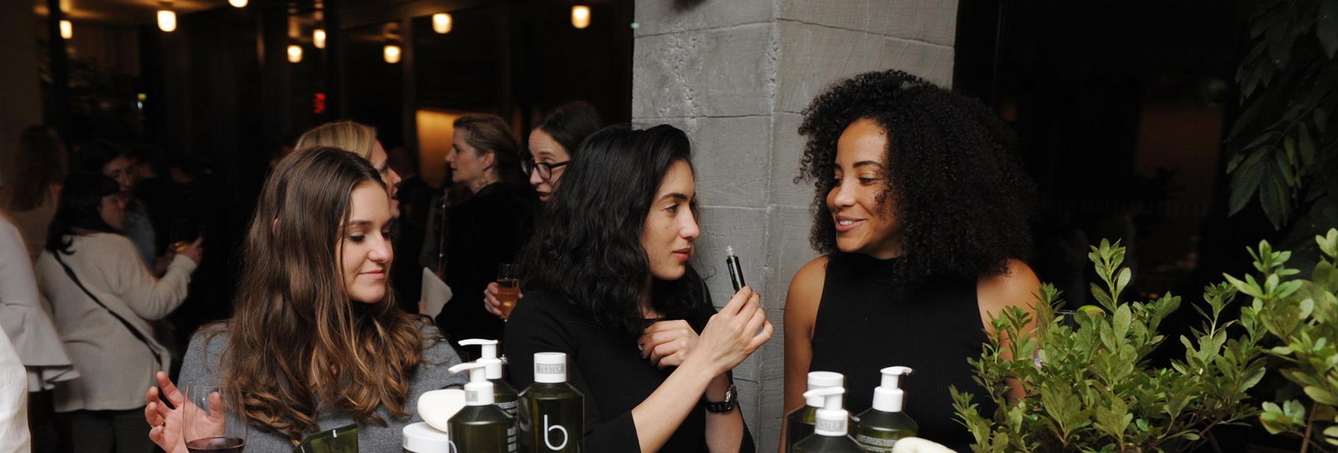 woman sniff skincare products at 1 hotel brooklyn event