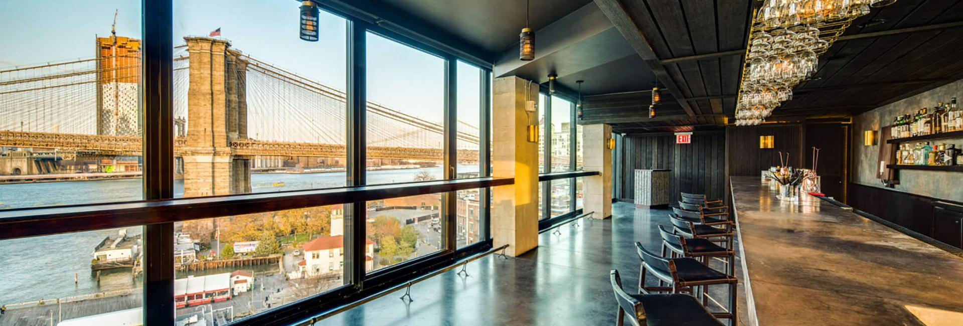10th floor lounge looking out at Brooklyn Bridge
