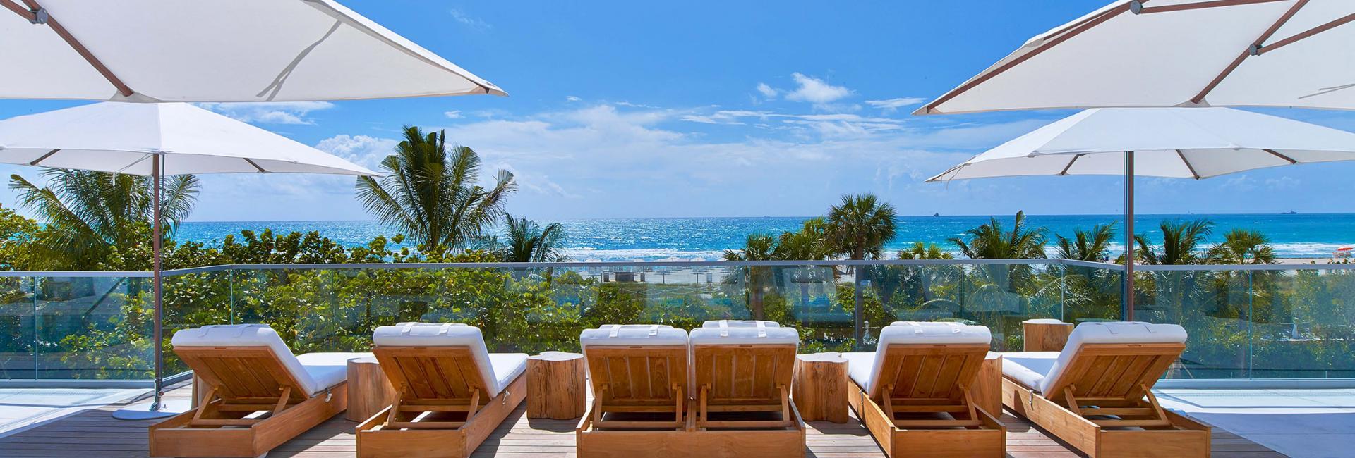 cabana day beds next to a pool
