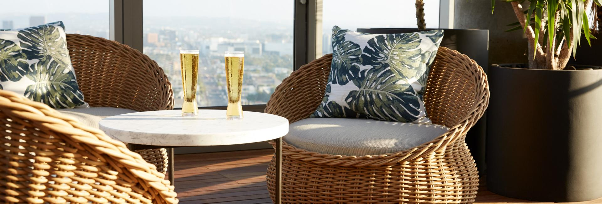 close up of two wicker chairs and drinks
