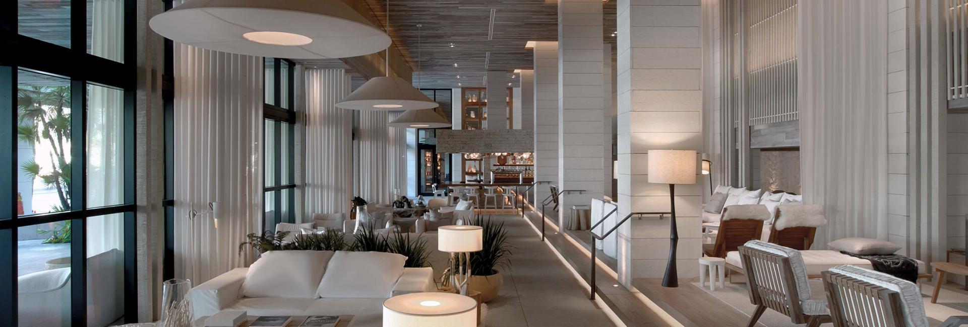 A white, modern hotel lobby.