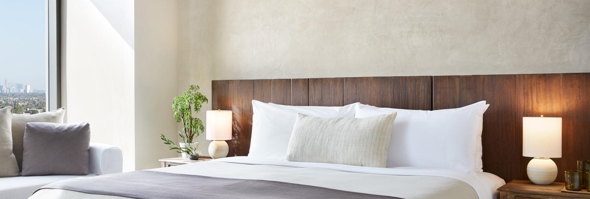 A modern and luxurious king bed made with natural materials