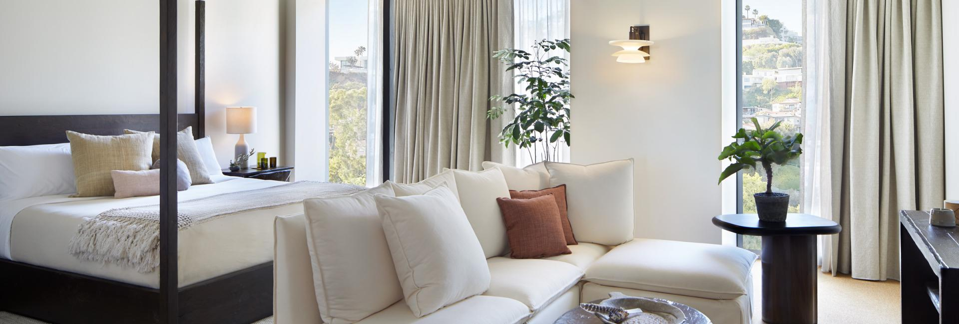 A white sectional in the living space of a studio suite