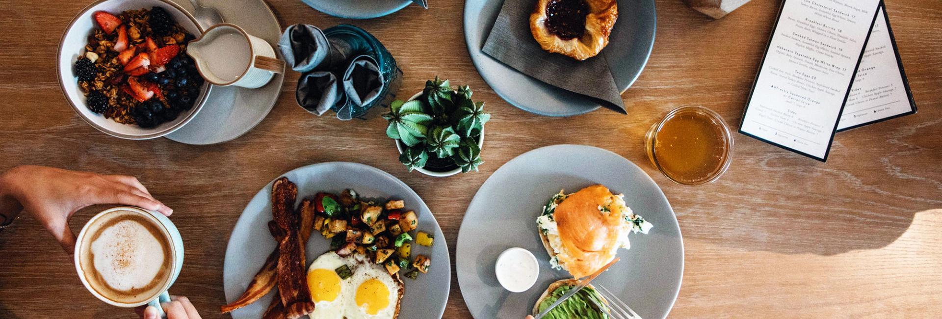Various plates of breakfast food