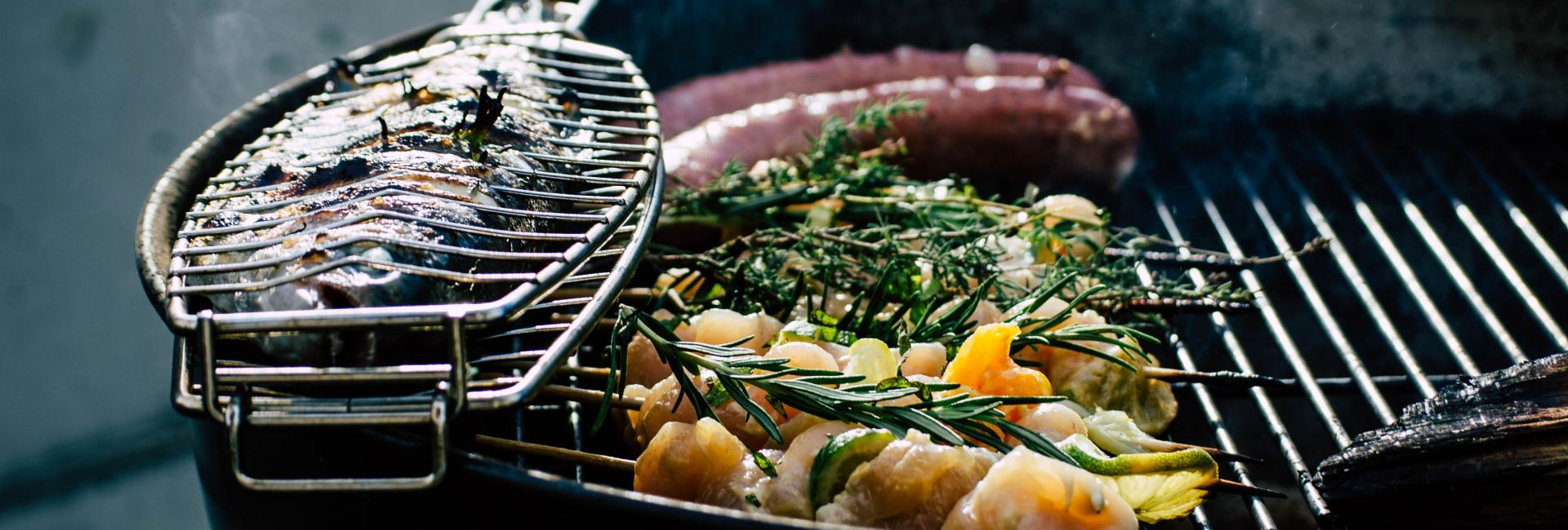 Grill with vegetables, fish and meat