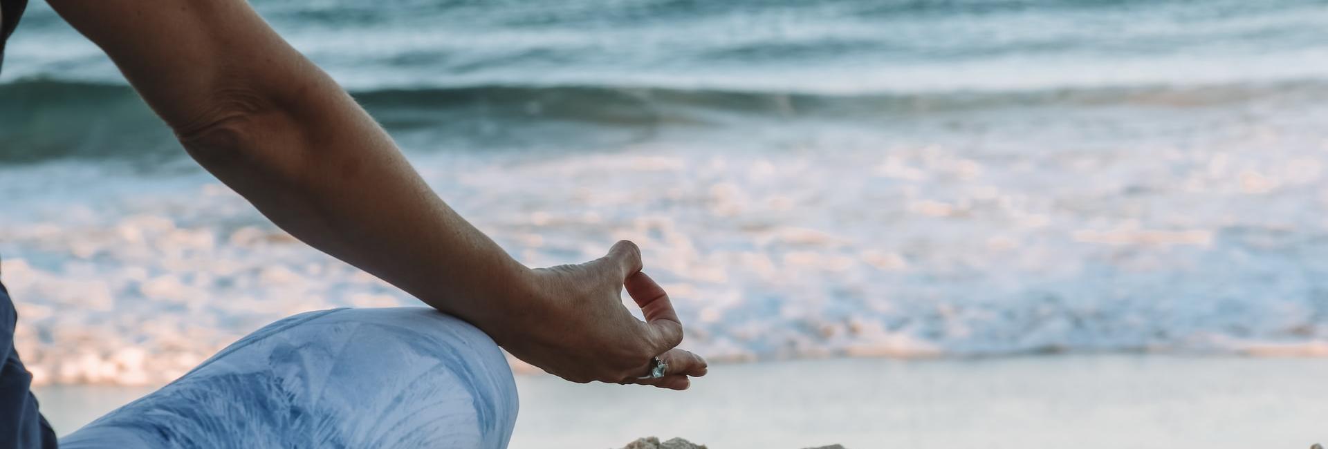 Yoga pose on the beach with ocean
