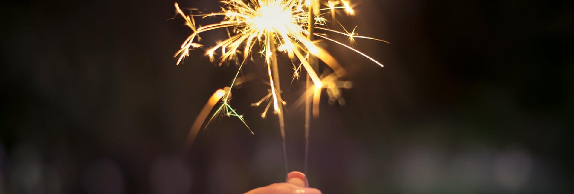 Hand holding sparkles