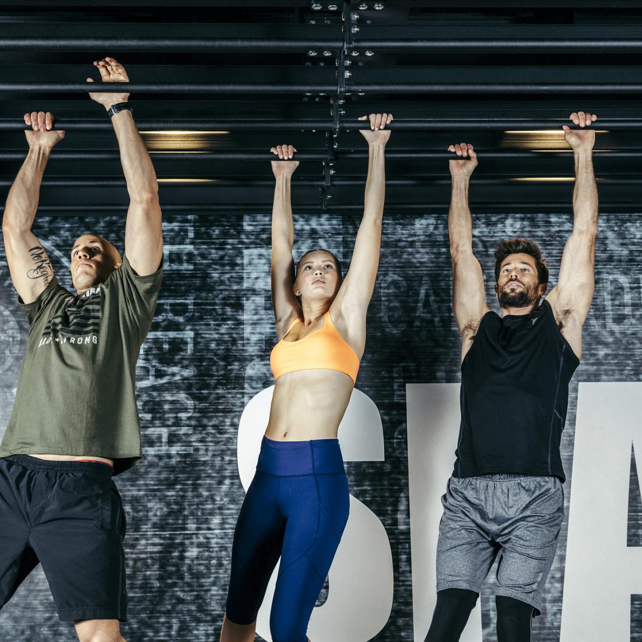 Three people training at Spartan gym