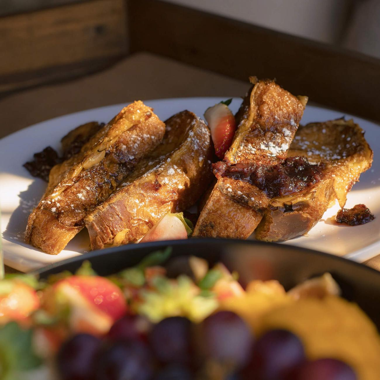 A close up of french toast and fresh fruit