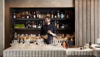 Bartender in front of fancy bar at Quarry Bar Brooklyn Bridge