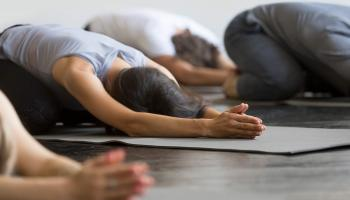 People doing a yoga pose
